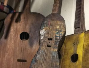 Handmade wooden guitars, on the left from Livingstone, in the middle from Angola and on the right from Central Zambia