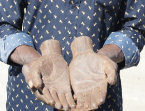 Lozi carver holding a sculpture of his own hands - Zambezi
